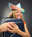 Girl embracing suitcase excited traveler in a hat from map Royalty Free Stock Photography