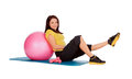 Girl engaged on the ball in the gym over white Stock Photo