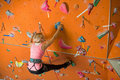 The girl is engaged in rock climbing on gym Royalty Free Stock Photo