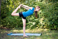 Girl is engaged in yoga yang on the nature Stock Images