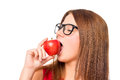 Girl enjoying a delicious red apple Royalty Free Stock Photo