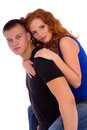 Girl enjoying piggyback ride on her boyfriend Stock Photo