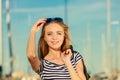 Girl enjoying summer breeze outdoor in marina Royalty Free Stock Photo