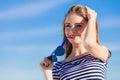 Girl enjoying summer breeze sky background Royalty Free Stock Photo