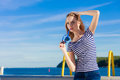 Girl enjoying summer breeze sky background Royalty Free Stock Photo