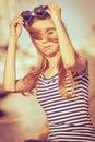 Girl enjoying summer breeze at sunset in marina Royalty Free Stock Photo