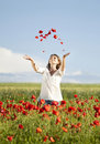 Girl enjoying summer in a poppy field young casual woman relaxing Royalty Free Stock Images