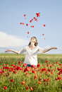 Girl enjoying summer in a poppy field young casual woman relaxing Stock Photo