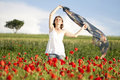 Girl enjoying summer in a poppy field young casual woman relaxing Stock Photography