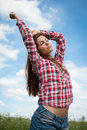 Girl enjoying the summer wind Royalty Free Stock Photo