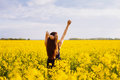 Girl enjoying sun on rapeseed meadow Royalty Free Stock Photo
