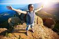 image photo : Girl  enjoys rise to the top of the mountain