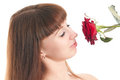 Girl enjoys a smell of rose Royalty Free Stock Photos