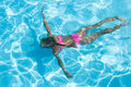 Girl enjoys an underwater swim in pool Stock Photo