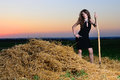 The girl in an evening dress with pitchfork Royalty Free Stock Images