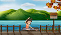 A girl excercising along the seaside illustration of Royalty Free Stock Photo