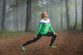 Girl exercise in the morning mist Stock Photography