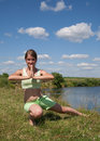 Girl in exercising on meadow Royalty Free Stock Photo