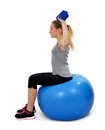 Girl exercising workout fitness aerobic on ball exercise shoulders Stock Image
