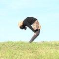 Girl exercising yoga on meadow