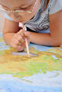 Girl exploring the map of Eurasia Royalty Free Stock Image