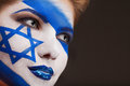 Girl with face art israel flag painted on a Stock Photos