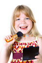 Girl with face brush Royalty Free Stock Images