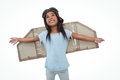 Girl with fake wings pretending to be pilot on white screen Royalty Free Stock Photo