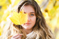Girl in fall portrait of a covering one eye leaf Stock Photos