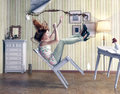 Girl falls from a chair in vintage room Stock Photos
