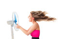 Girl with fan over white young woman cooling face under wind of cooler isolated on background Stock Photo