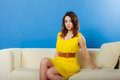 Girl fashionable dress sitting on couch. Royalty Free Stock Photo