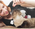 Girl feeding  cat Royalty Free Stock Photo