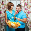 Girl feeding her boyfriend an attractive young couple ripe apple Royalty Free Stock Photos