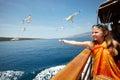 Girl feeding the seagulls Royalty Free Stock Photo