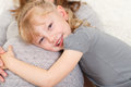 Girl feeling her mother s pregnant belly little hugging mothers Royalty Free Stock Images