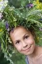 Girl in field flower garland Stock Image
