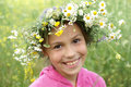 Girl in field flower garland Royalty Free Stock Photos