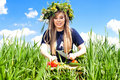 Girl in a field of flowers cut vegetables Royalty Free Stock Photos