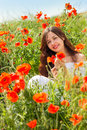 Girl in a field of poppies Royalty Free Stock Photo