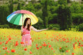 Girl in field young beautiful poppy with umbrella Royalty Free Stock Photography