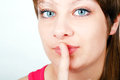 Girl with a finger to his lips Stock Image