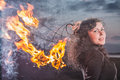 The girl and fire acts with Stock Photography