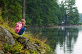 Girl fishing on the bank of a lake Royalty Free Stock Photo