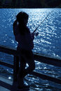 Girl fishing a silhouette of a on a lake Royalty Free Stock Photos