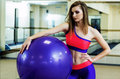 Girl with fitness ball. Royalty Free Stock Photo