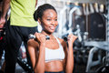 Girl in fitness gym exercising her shoulder Royalty Free Stock Photo