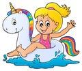Girl floating on inflatable unicorn 1