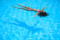 Girl floating in the pool