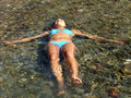 Girl floating in the sea water Royalty Free Stock Photo